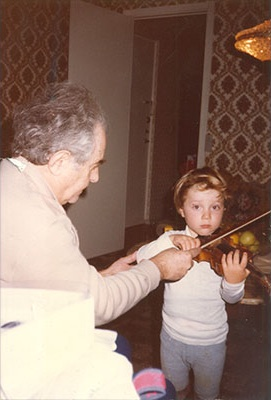 Violin lessons, three years old with my grandfather, Vladimir Yeshayavitch Novak