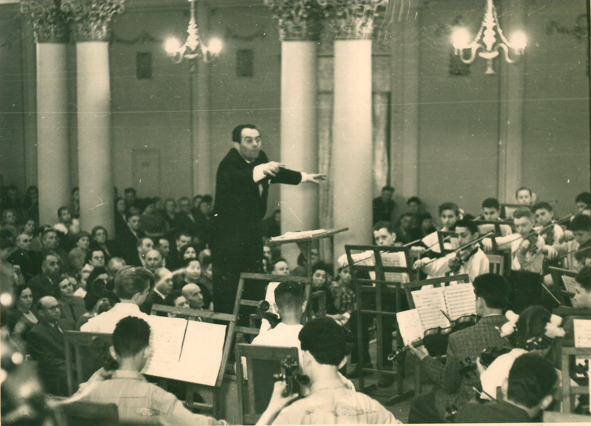 Vladimir Yeshayavitch Novak, a beloved and honored violin pedagogue and violinist in Kiev Philharmonic. Conducting the youth orchestra in the historic concert hall in the Khrestchaty Park in Kiev, Ukraine.